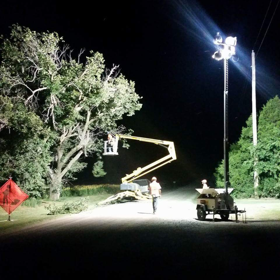 nighttime tree trimming done by Wichita tree service llc employees.